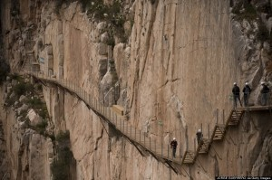 "Journalists walk during a visit to the foot-path ""El Caminito del Rey"" (King's little path) a narrow walkway hanging and carved on the steep walls of a defile in Ardales near Malaga on March 15, 2015. The one meter wide and 7.7 km long path, hanging from Ardales' defile at 100 meter high, was closed in the mid 90's after several hikers resulted dead when walking it. Once restored it will be reopened to the public on March 28, 2015. AFP PHOTO/ JORGE GUERRERO (Photo credit should read Jorge Guerrero/AFP/Getty Images)"